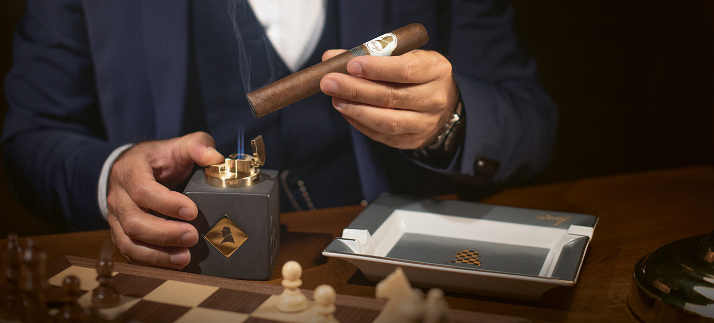 The Davidoff Winston Churchill Cigar 2021 being lit with the table lighter